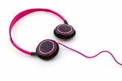 Pink headphones. Stock Photos