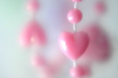 Pink heart. Perls with blur background Stock Image