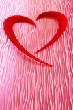 Pink Heart. A stained glass window with an an artistic heart sculpture forms the basis for this computer enhanced background Royalty Free Stock Image