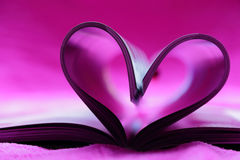 Pink heart. Shape made with book pages Stock Image
