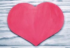 Pink heart on the background tinted wooden planks Stock Images