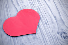 Pink heart on the background tinted wooden planks Royalty Free Stock Photo