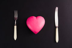 Pink heart on a black background Stock Images