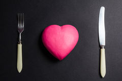 Pink heart on a black background Stock Photography
