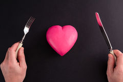 Pink heart on a black background Stock Photos