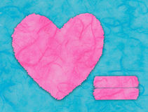 Pink heart on blue Royalty Free Stock Photography