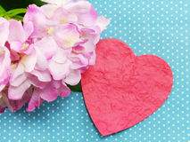 Pink heart on blue polka dot background and beautiful flower Royalty Free Stock Image