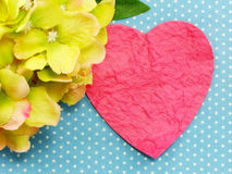 Pink heart on blue polka dot background and beautiful flower Stock Images