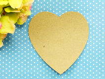 Pink heart on blue polka dot background and beautiful flower Stock Image