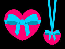 Pink heart with blue ribbon Royalty Free Stock Photography