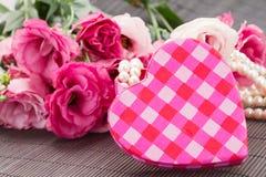 Pink heart box fresh  flowers Stock Photos