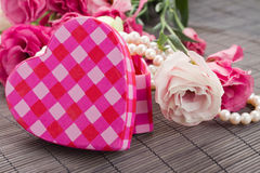 Pink heart box with pearls and flowers. Pink heart shaped box with pearls and euatoma flowers stock photography