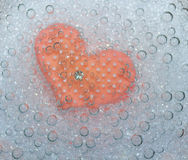 Pink heart in bubbles. Pink heart in mineral bubbles Stock Photography