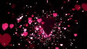 Pink heart confetti and sparks flying against heart. In slow motion stock video