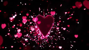 Pink heart confetti and sparks flying against pink heart. In slow motion stock footage