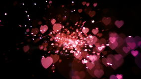 Pink heart confetti and sparks stock video footage