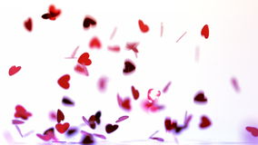 Pink heart confettis falling on the floor. In the slow motion stock footage