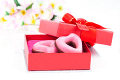 Pink heart cookies for valentines day in red gift Stock Image