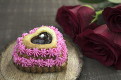 Pink Heart Cupcake With Ganache Filling, and Red Roses Royalty Free Stock Photography