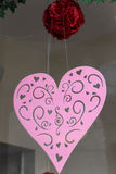 Pink heart. Decorative pink felt heart hanging in a shop window Royalty Free Stock Photo