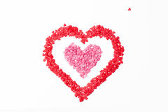 Pink heart frame red heart on a white background and one little heart. Royalty Free Stock Photography