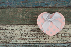 Pink Heart gift box on vintage wood table Stock Image