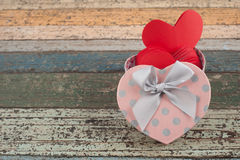 Pink Heart gift box on vintage wood table Royalty Free Stock Photos