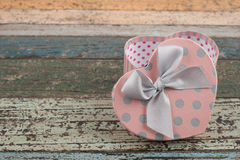 Pink Heart gift box on vintage wood table for your love Royalty Free Stock Photo