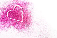 Pink heart in glitter with copy space. Pink glitter shaped as a heart on white background. Focus is in front of the heart Royalty Free Stock Photography