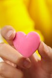 Pink heart in the hand Royalty Free Stock Photos