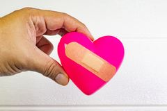 Pink Heart and hand for medical content. The pink Heart and hand for medical content stock photo