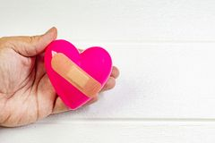 Pink Heart and hand for medical content. The pink Heart and hand for medical content royalty free stock image
