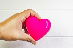 Pink Heart and hand for medical content. The pink Heart and hand for medical content royalty free stock photos