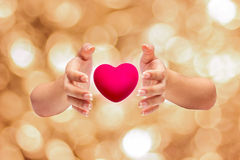 Pink Heart in hands on nature background Royalty Free Stock Photography