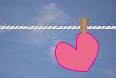 Pink heart hanged on white rope Stock Image