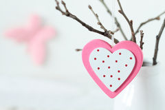 Pink heart hanging on a tree branch Stock Image