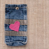 Pink heart on a jeans pocket Royalty Free Stock Image