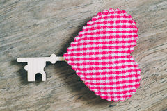 Pink heart key on wooden for valentine background, vintage color. Tone royalty free stock image