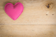 Pink heart love symbol on wood Royalty Free Stock Images