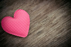 Pink heart love on wood background Stock Image