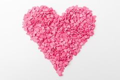 Pink heart made of many smaller hearts on a white background Royalty Free Stock Photos
