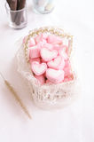 Pink heart marshmallow in Vintage basket Royalty Free Stock Photo