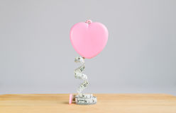 Pink heart Measuring Tape on white background. Pink heart Measuring Tape on wood and white background Royalty Free Stock Photo