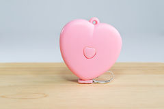 Pink heart Measuring Tape on wood. And white background Royalty Free Stock Photos