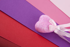 Pink heart on multicolored. Pink sparkling heart on multicolored background Stock Photography