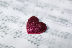 Pink Heart and Music. A sparkling pink heart and musical notes royalty free stock images