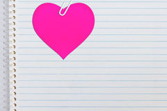 Pink heart on notebook paper Stock Photo
