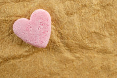 Pink heart over grunge vintage old paper background. Valentines Day background idea Royalty Free Stock Photo