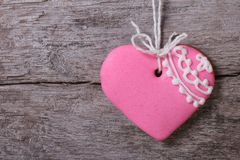 Pink heart with a pattern on a background of wooden board. Royalty Free Stock Photos