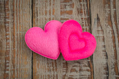 Pink Heart pillow on wood background . Royalty Free Stock Images
